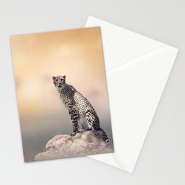 Young Cheetah sitting on a rock Stationery Cards
