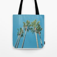 palm tree Tote Bags featuring Palm tree by Laura James Cook