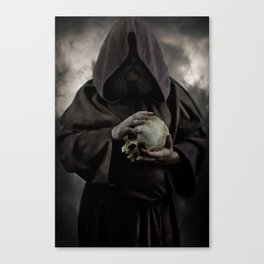 Holding a male skull Canvas Print