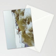 Sand dunes and beach huts in snow. Wells-next-the-sea. Stationery Cards