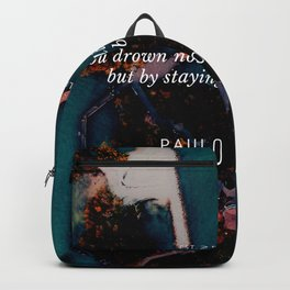 Paulo Coelho Quote |You drown not by falling into a river, but by staying submerged in it. Backpack