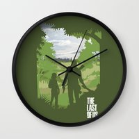 the last of us Wall Clocks featuring The Last Of Us by Pixel Design
