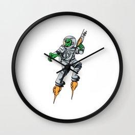 Alien in an astronaut suit with laser gun Wall Clock