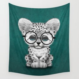 Cute Snow Leopard Cub Wearing Glasses on Teal Blue Wall Tapestry