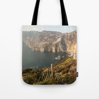 league Tote Bags featuring Slieve League by Marie Carr