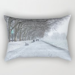 Leaving footprints under the cold freezing snow by the Lake Annecy in France Rectangular Pillow