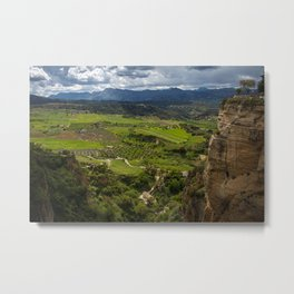 Cliffs in the city of Ronda, Spain. View of the field covered with clouds. Metal Print