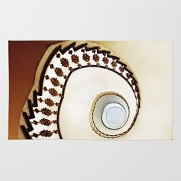 Spiral staircase in warm colours Rug