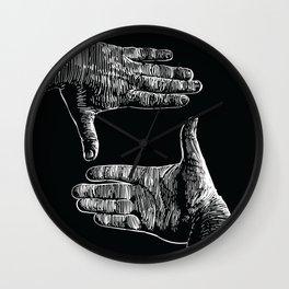 hands framing Wall Clock