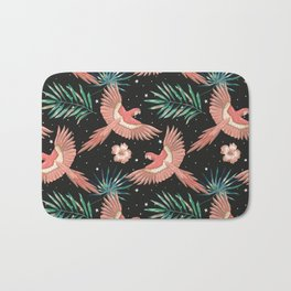 Pink macaw parrots on the starry night sky Bath Mat