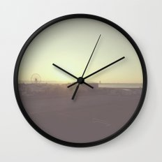 The sunrise and Ferris wheel Wall Clock