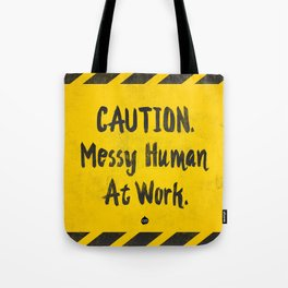 CAUTION. Messy Human At Work Tote Bag