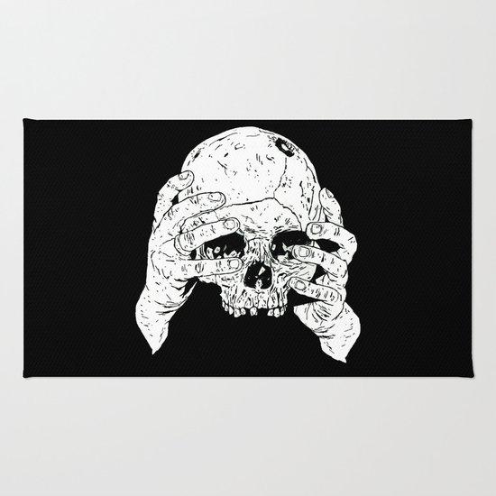 Skull In Hands Rug