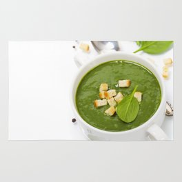 Traditional Spinach cream soup with croutons and fresh spinach leaf on top Rug