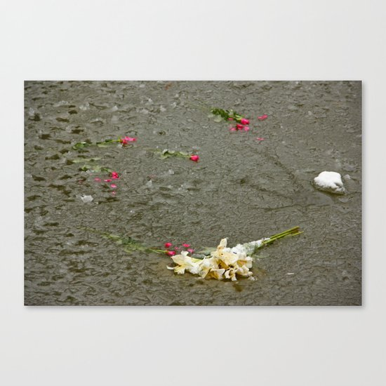 Flowers in a frozen pond Canvas Print