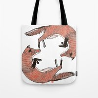 foxes Tote Bags featuring Foxes by nicolaporter