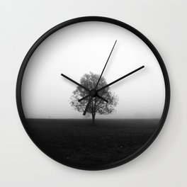 Lonely tree in fog black and white Wall Clock