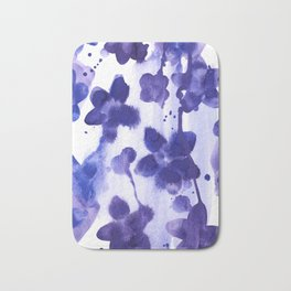 Floral splash: Abstract watercolor painting in purple and blue Bath Mat