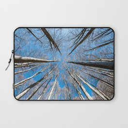 Upward perspective view of tall trees on a blue sky background Laptop Sleeve