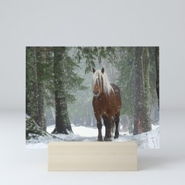 Brown Horse in a Winter Forest with Snow Falling Down Mini Art Print