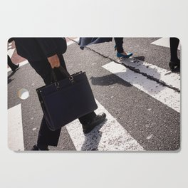Group of businessmen and women walk along crosswalk in Shinjuku, Tokyo, Japan Cutting Board