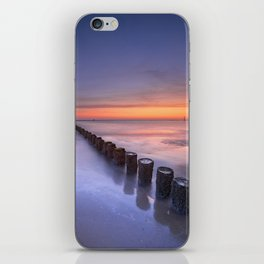 Breakwater on the beach at sunset in Zeeland, The Netherlands iPhone Skin