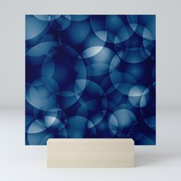 Dark intersecting translucent sea circles in bright colors with a blue glow. Mini Art Print