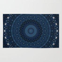 Mandala in light and dark blue tones Rug
