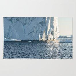 icebergs at midnight - disko bay Rug