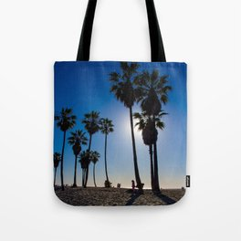 Sun on palm tree Tote Bag