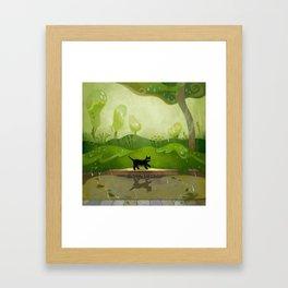 Kitty on a rainy day Framed Art Print