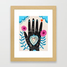 Heart in your hand Framed Art Print