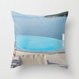 Empty infinity pool on the sunrise, quiet bue sea Throw Pillow