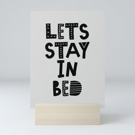 Lets Stay in Bed typography wall art home decor in black and white Mini Art Print