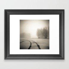 Tyre tracks in snow Framed Art Print