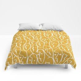 faces / mustard Comforters
