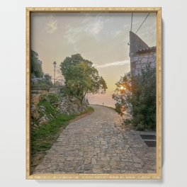 Little alley in the medieval center of the village Rovinji at sunset Serving Tray