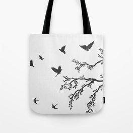 flock of flying birds on tree branch Tote Bag