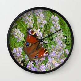 A Peacock Butterfly On A Laveder Bush Wall Clock