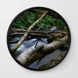 Green forest with river and fallen tree Wall Clock