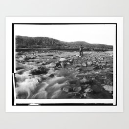 Man with rifle stands in mountain stream as it floods, east of Palmdale, California, ca.1920 Art Print