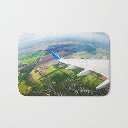 View through airplane porthole  Bath Mat