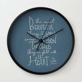 """The Little Prince quote """"the most beautiful things"""" Wall Clock"""