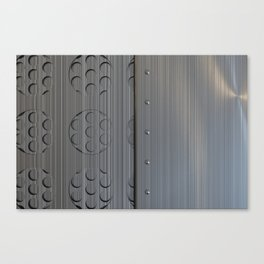 Brushed metal plate with rivets and circular grille Canvas Print