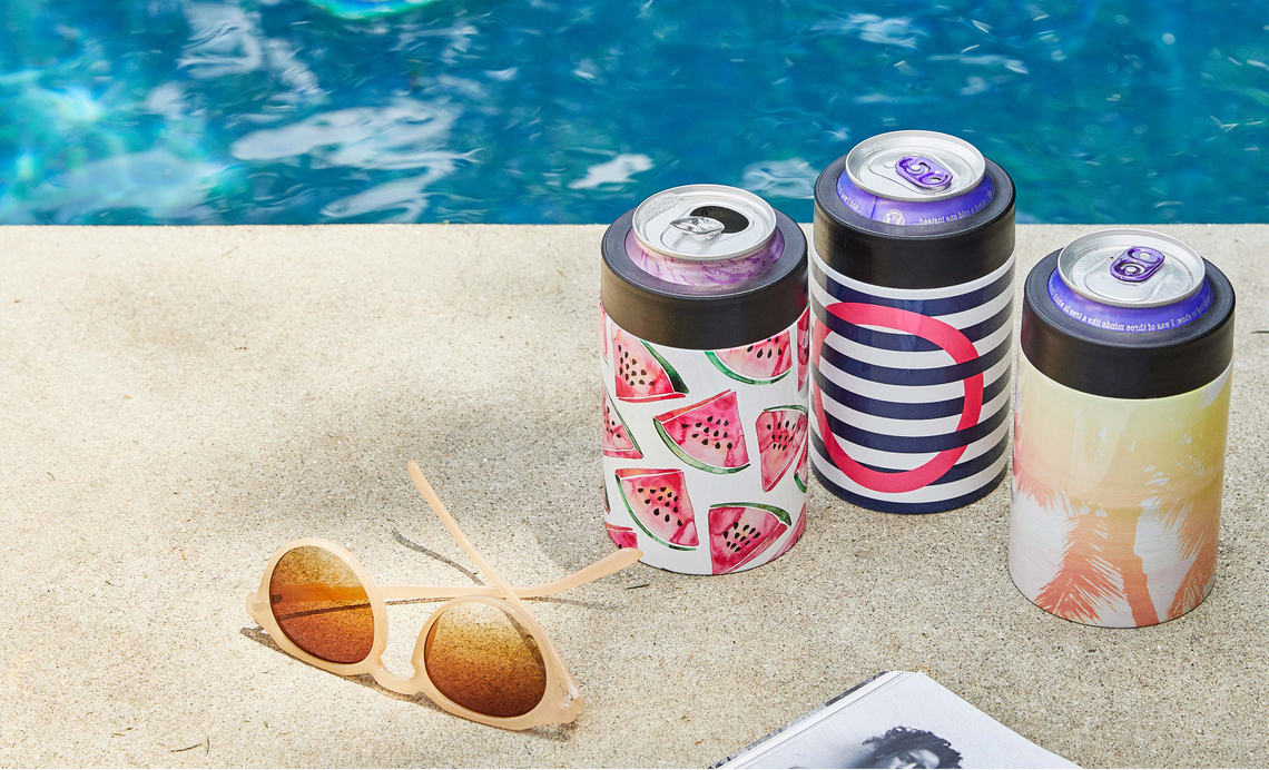 abstract and fruit patterned can coolers next to a pool