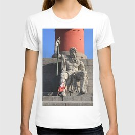 Figure of a man with a paddle sitting at the foot of the Rostral column. A little girl jumps over he T-shirt