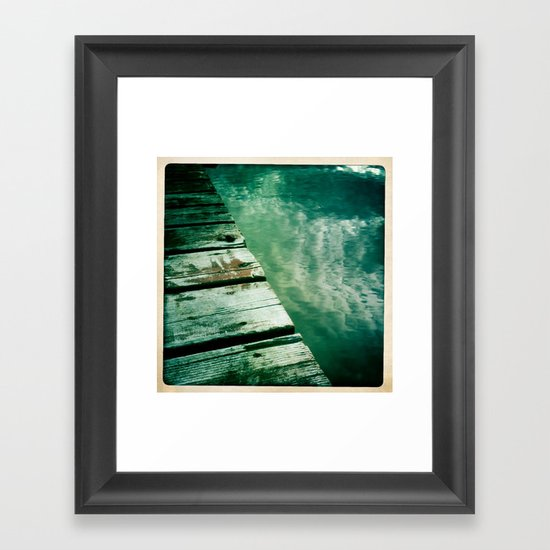 dock water and clouds Framed Art Print