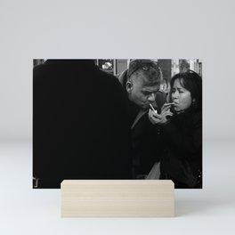 Woman Lighting a Cigarette to a Man Mini Art Print