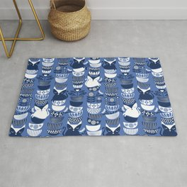Swedish folk cats I // Indigo blue background Rug