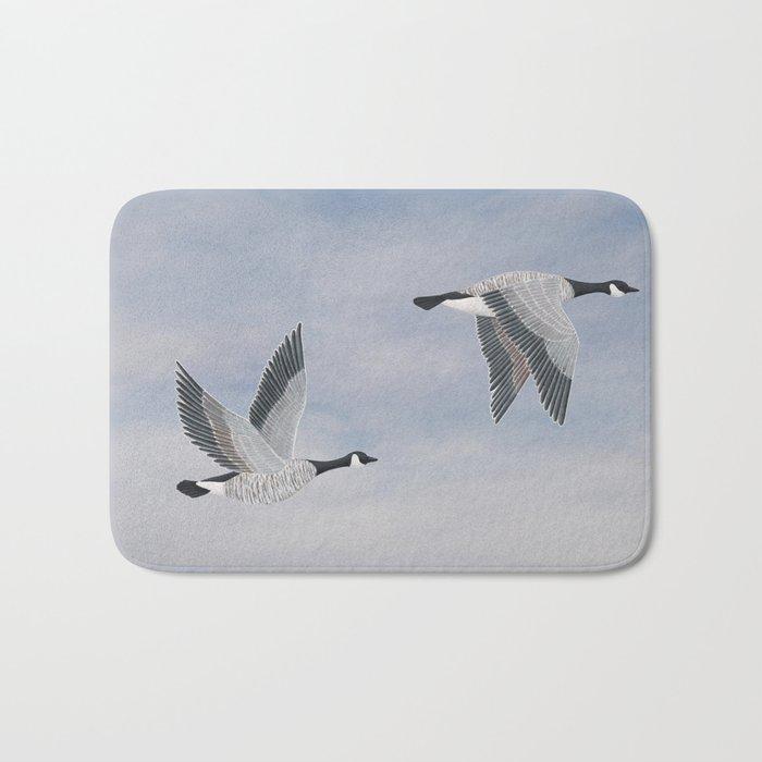 Canada geese and blue sky Bath Mat